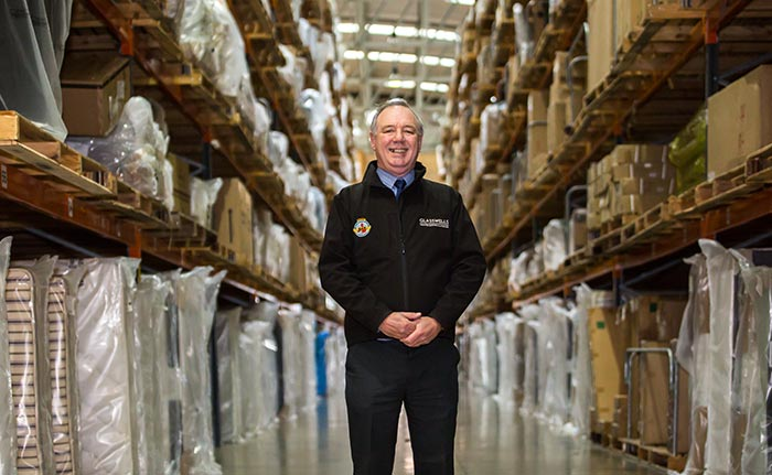 Bob Allen Glasswells Removals Manager Standing in Warehouse