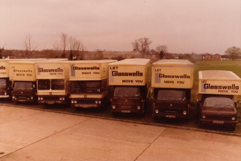 Line of Glasswells Removals trucks from the 1970's