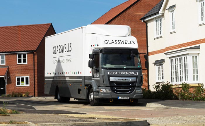Glasswells Removals truck outside a house