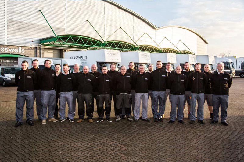 Glasswells Removals team photo standing outside the Bury St Edmunds warehouse
