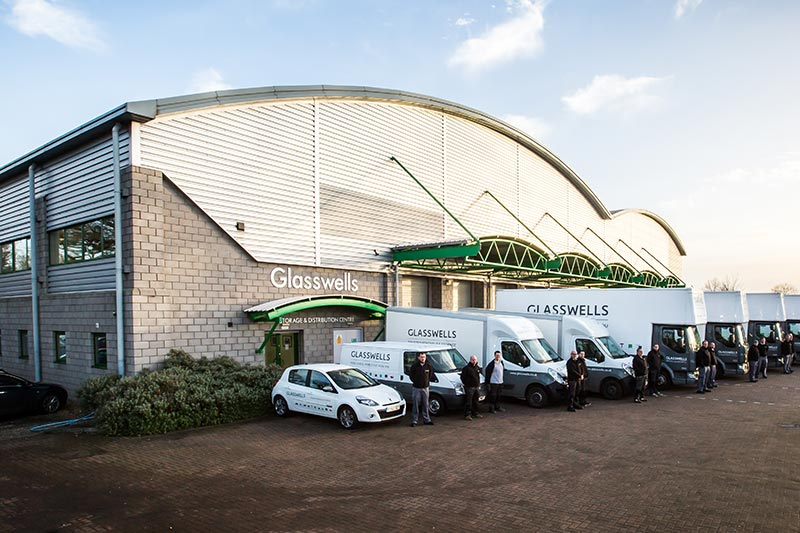 New removals fleet lined up outside Glasswells warehouse