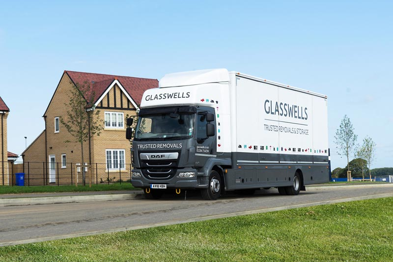 A Glasswells removals truck parked on a Bury St Edmunds estate
